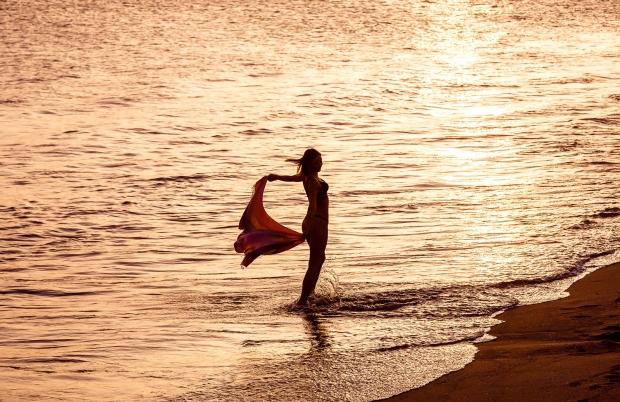 dancing girl in ocean