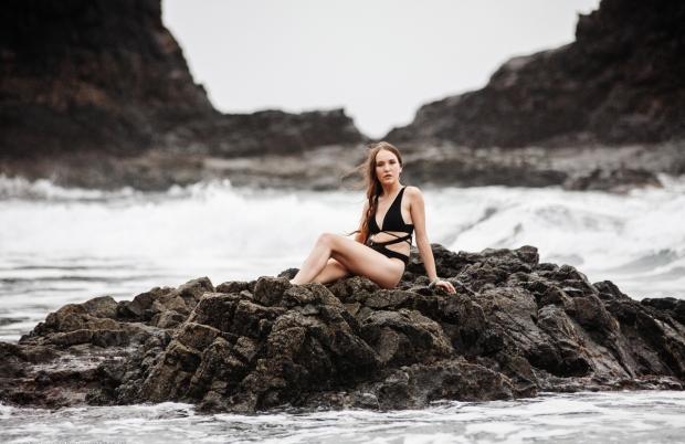 Girl between the waves